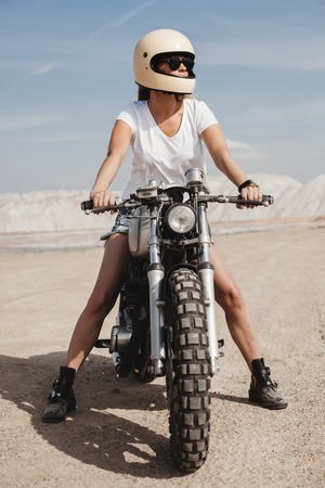 Woman Riding a Motorcycle on sand