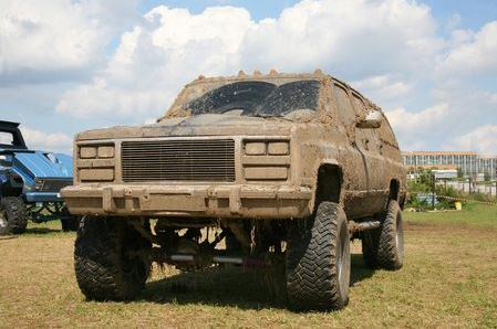 A large truck caked in mud