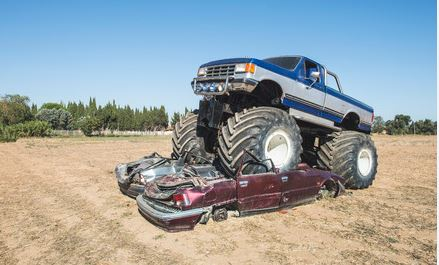 Blue and Grey Monster Truck Crushing 2 Cars